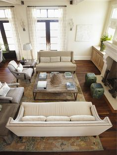 Colors, furniture arrangement, coffee table. Love the neutral colors with the pop of green.