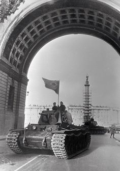 World War II, the Siege of Leningrad. Soviet KV-1 tanks during the parade on the Palace Square in Leningrad, Russia, 1 May 1942. Photo by Boris Kudoyarov.