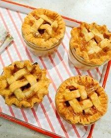 """Apple-Cheddar-Rosemary Piejars Is there a more delicious way to fill a glass jar? This mini pie recipe comes from baker Dani Cone's """"Cutie Pies"""" cookbook. Mini Fruit Pies, Mini Pies, Fun Desserts, Delicious Desserts, Yummy Food, Dessert Ideas, Apple Desserts, Yummy Yummy, Yummy Treats"""