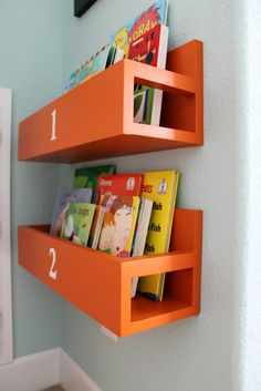 Combat clutter by installing bookshelves at just the right height for your mini reader (via the sweet survival)