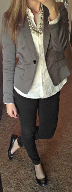 Slim black pants, grey blazer, white shirt.