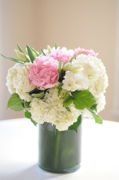 white hydrangeas, pink peonies, small tulips, and freesia