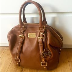 MICHAEL KORS BEDFORD SATCHEL - LUGGAGE BROWN BEDORD medium-sized satchel from MICHAEL KORS in a luggage-brown color. Satchel includes a crossbody strap, exterior cell phone pocket, one interior zip pocket and three interior open pockets. This satchel is BRAND NEW WITH TAGS. Never been used and is in mint condition. Purchased from MK Factory as a gift for my sister but apparently it is not in her style. Feel free to make an offer! Michael Kors Bags Satchels