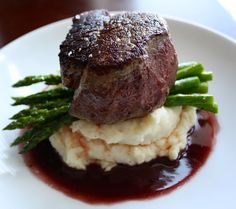 Filet Mignon with Red Wine Pan Sauce + Roasted Asparagus + Garlic Mashed Potatoes with Yukon Gold Potatoes, Garlic Cloves, Fresh Asparagus, Extra-Virgin Olive Oil, Filet Mignon, Kosher Salt, Cracked Black Pepper, Shallots, Red Wine, Beef Stock, Unsalted Butter, Heavy Cream.