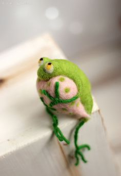 This little needle felted Frog was born in Sofia a few days ago. He is made of pure wool and and embraced pink heart. He is waiting for his beloved lady. He is little but not afraid of storks. I use felt needle techniques and 100% pure wool form Bulgaria. I dye the wool by myself to