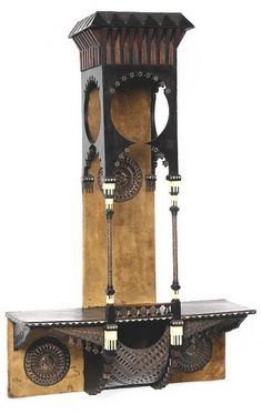 CARLO BUGATTI, HANGING SHELF, ebonized wood, bone, copper, pewter and felt, 37 1/2 x 24 x 9 in. (95.2 x 61 x 22.7 cm), ca. 1900 | SOLD $9,600 Sotheby's New York, March 10, 2005 Art Nouveau Furniture, Antique Furniture, Furniture Design, Bugatti, Muebles Art Deco, Wood Table Design, House Front Design, Hanging Shelves, Candlesticks