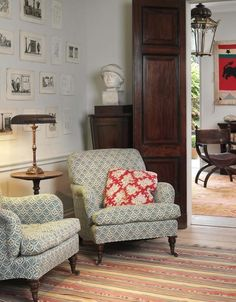 The prints on the wall are unframed and lend a contemporary feeling to the room.