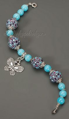 Pretty bracelet with a charm. I think a different color because this color wouldn't go with much.
