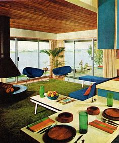 A super hip mid-century modern living room, 1967. Love the glass walls and the blue and green color scheme