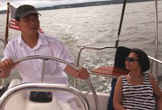 """SAILING FROM SAIGON – Hue and Hung Ngo of Fairfax took their 9-year-old son sailing on a quiet day on the York River, long removed from their native Vietnam. They emigrated in the mid-1990s after eight years of processing by the communist government. """"No siblings were allowed to leave together, and no parents,"""" Hue explained. """"It's easier today because the country is slowly learning how to govern. They realize the benefit of money sent back by families to Vietnam."""""""