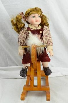 shopgoodwill.com: Green Eyed Porcelain Doll on a Hobby Horse