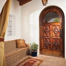 OMG -- look at those doors!   A Spanish Colonial Home Embraces the Outdoors - Phoenix Home & Garden