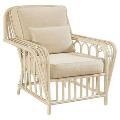A breezy addition to your sunroom or den, this island-inspired arm chair showcases an openwork frame, a weathered finish, and cushioned seat.