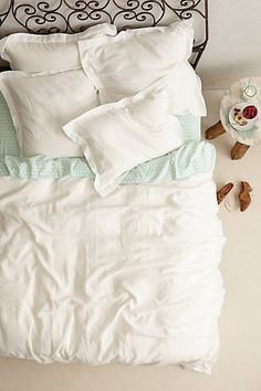 my husband only likes white bedding, but he didn't say anything about the color of the sheets - love incorporating a pattern on the sheets & quilt to add some pop in a white room #Anthropologie #PinToWin