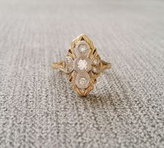 This Amazing Antique Ring Features a 14K Two Toned White and Yellow Gold Setting with .25 Carats of Natural Old European Cut Diamonds! Just Stunning Ring!! Makes a wonderful Conflict free Engagement ring!    Size 7.25    FOR RING SALES  You have 7 days to inspect any jewelry, diamond or