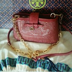 "HP%Tory Burch✨✨✨ %AUTHENTIC NO TRADEUsed once like new Tory Burch all over crystal smart phone crossbody. , wallet the must have minibag silhouette over pave crystals finished with a tiny bow and logo charm it can be worn messenger style or carried a clutch when you remove the chain link strap,  very nice color , comes with protective dust bag. , 7"" length  4""high strap 44""....inside the minibag has a small spot a show in the picture. ..see pic for details. . Tory Burch Bags Mini Bags"