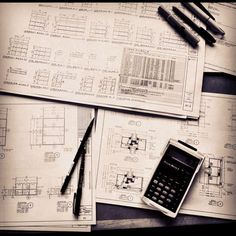 shop drawings and a calculator