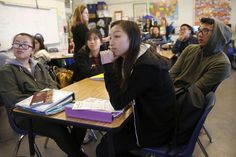 Lincoln High 11th-graders Lily Guan (clockwise from left), Sandy Shieh, Yeremia Junaedy and Christy Ly listen to history teacher Valerie Ziegler teach them sourcing. Photo: Liz Hafalia, The Chronicle