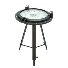 Metal tripod end table with a clock top.Product: End tableConstruction Material: Metal and glassColor: Pewter and whiteDimensions: 24 H x 17 DiameterCleaning and Care: Wipe with a dry cloth
