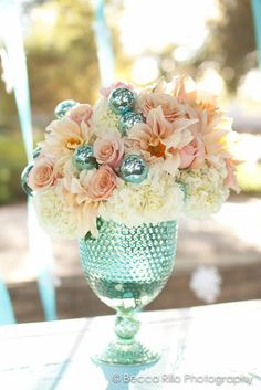 Christmas. Aqua, teal, peach, white.  Floral arrangement. Enchanted Garden Floral Design.  www.egfloraldesign.com