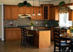 love the tile idea between cabinets and counter top...brown cabinets in new house and I had noooo good color ideas!