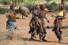 Laughing women in a Hammer tribal ritual - the bull jumping. Ethiopia.