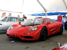 A bright red McLaren in the paddock at Laguna Seca Fast Sports Cars, Exotic Sports Cars, Sport Cars, Exotic Cars, Gt Cars, Race Cars, Mclaren Cars, Life Car, Online Cars