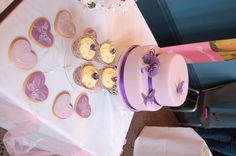 Lilac Wedding Cake with matching cookies and cupcakes - violet roses and butterflies