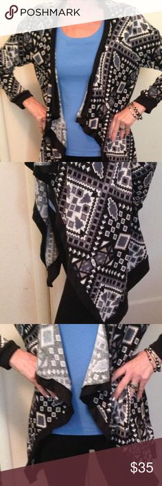 Navajo print open knit cardigan Beautiful open Knit flattering Cardigan. Poly/Spandex blend. Super comfy and will go with everything in your closet. Black and Gray with a touch of blue. NWOT. Sweaters Cardigans