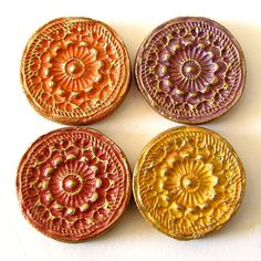 Clay magnets. I love the motif on them and I would like to have some of them for my fridge next year.