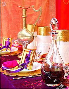 Gold picture frames tied with purple ribbons. Favor ideas for a Moroccan or Arabian Night's theme.