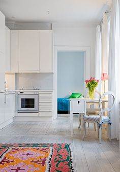 white. simple. that rug.