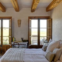 I wish we had exposed beams like these in our bedroom . :-)
