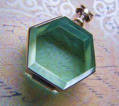 Glass locket! I want one of these to put a lock of hair from my son's first haircut inside.