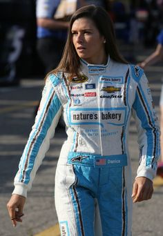Danica Patrick Photos - Danica Patrick, driver of the #10 Nature's Bakery Chevrolet, walks in the garage area during practice for the NASCAR Sprint Cup Series FireKeepers Casino 400 at Michigan International Speedway on June 11, 2016 in Brooklyn, Michigan. - Michigan International Speedway - Day 2