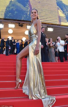 "Izabel Goulart: Wore a gold Alexandre Vauthier Couture gown with a high slit, wore the DARCIE sandal in blush pink (Giuseppe Zanotti), Jewels (Boucheron Boucheron) |   ""The Last Face"" Premiere during the 69th annual Cannes Film Festival at the Palais des Festivals on May 20, 2016"