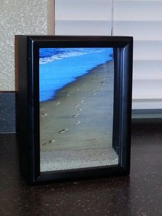 take a picture of your footprints in the sand from one of your walks on the beach, put it in a shadow box with some sand from the beach for a 3D effect.