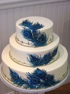 Brides: All Things Peacock : cakes for occasions...  If peacocks are your theme have the designer handprint the feathers on white fondant a metallic-teal cake with the feathers in fondant is not advised.