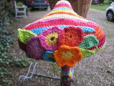 Crochet bike seat cover.
