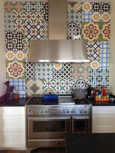 Cement Tiles as Backsplash Tile http://www.onekindesign.com/2014/05/19/create-decorative-kitchen-backsplash-cement-tiles/