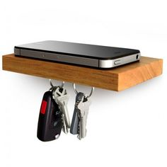 Magnetic Storage Plank - holds phone, keys, wallet! magnetic strip on bottom won't affect anything!  love it...