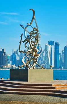 Picture of DOHA, QATAR - FEBRUARY The Corniche promenade is decorated with Calligraphy sculpture of Sabah Arbilli, based on poem of the founder of Qatar, on February 13 in Doha. stock photo, images and stock photography. February 13, Banner Printing, Facebook Image, Doha, Image Photography, Middle East, Indoor Outdoor, Image Search, Backdrops