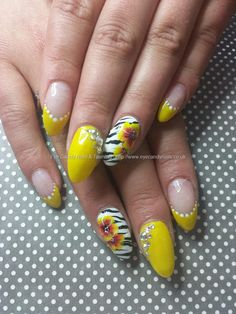 Yellow gel polish with zebra and one stroke flower nail art