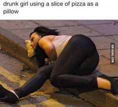 Drunk girl using a slice of pizza as a pillow