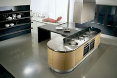 Cook top and sink on the island is ideal, and the T shape dining segment.