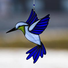 Hummingbird, stained glass hummingbird suncatcher, stain glass blue humming bird ornament on Etsy #StainedGlassFish