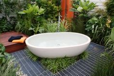 Outdoor bathroom with deck and shower at rear by Caroline Wesseling Landscapes