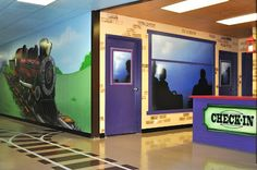 Take a look at this fun airbrush project that incorporates wall-to-wall murals along with large appliqués and nice touches including crossing guards, fun signage and a depot check-in area. Worlds Of Wow, Cool Playgrounds, Sunday School Rooms, School Hallways, Kids Church, Church Ideas, Church Nursery, Train Party, College Station