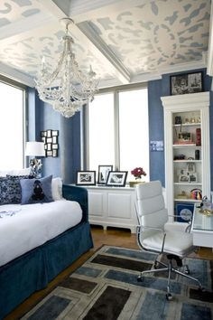 the decor, the colours, that ceiling! I particularly love the built in bookcase and the chandelier. White with dusty blue is so dreamy!