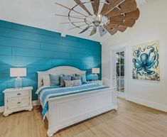 Making the bedroom really stand out with a blue painted shiplap accent wall in this Florida home. Featured on Completely Coastal.